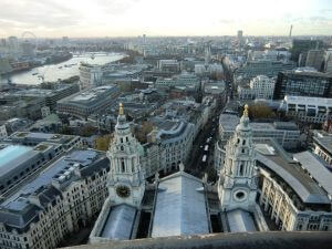 Views over the city of the greyish London, with the river Thames to the left, from St. Paul's Cathedral.