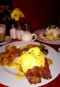 Eggs Benedict with bacon and fried potatoes
