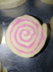 A roll of dough with a light pink filling