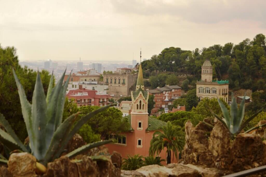 Views from Parc Güell. Houses with towers surrounded by palm and other trees