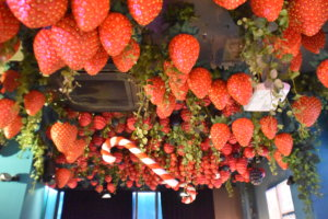 Strawberries and candy canes as ceiling décor.