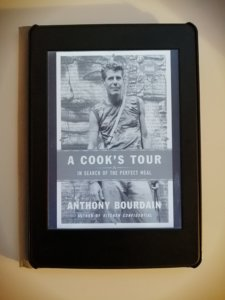 "The cover of the Kindle version of Anthony Bourdain's ""A Cook's Tour,"" which is a picture of the chef and writer"