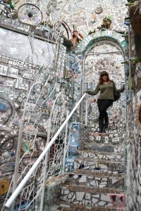 Iris in the magic gardens of Philadephia, a garden with the walls and floors covered in broken tile.